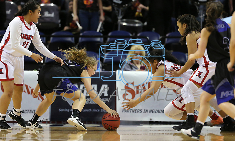 Liberty's Alapese Matauti, right, and McQueen's Mackenzie Corkill reach for a loose ball during the NIAA state basketball tournament in Reno, Nev., on Thursday, Feb. 22, 2018. Liberty defeated McQueen 71-33. Cathleen Allison/Las Vegas Review-Journal