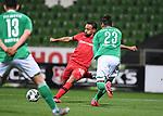 Zweikampf, Duell  Karim Bellarabi (Leverkusen) gegen Theodor Gebre Selassie (Bremen).<br /><br />Sport: Fussball: 1. Bundesliga: Saison 19/20: 26. Spieltag: SV Werder Bremen - Bayer 04 Leverkusen, 18.05.2020<br /><br />Foto: Marvin Ibo GŸngšr/GES /Pool / via gumzmedia / nordphoto