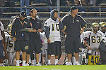Lawndale, CA 10/21/11 - Coach Larry Olson, Coach James McCashin, Marco Catallo (Peninsula #10) and Coach Will Patterson in action during the Peninsula - Leuzinger varsity football game.
