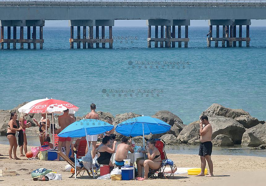 La spiaggia della zona industriale di Termini Imerese, il tratto antistante l'ex stabilimento Fiat, inquinata, in abbandono e con il divieto di balneazione. <br /> The beach of the industrial hub of Termini Imerese, just in front of former Fiat factory, polluted and with bathing prohibition