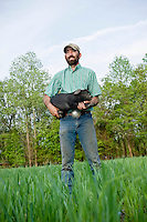 Jeremiah Jones and one of his pigs at Beaulaville, NC pig farm - Grassroots Pork Co.