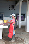 cutting fish at the fish market in puerto lopez ecuador