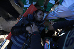 An injured journalist is evacuated during clashes following a protest on the beach along the northern Gaza border, across from the Israeli settlement of Kibbutz Zikim, on  March19, 2019, as part of weekly maritime protests against the naval blockade of the coastal enclave. Many attempts have been made throughout the years to draw the public's attention to the ongoing siege of the Gaza Strip whether via ships attempting to sail into or out of Gaza. Photo by Ashraf Amra