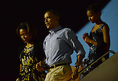 United States President Barack Obama, first lady Michelle Obama, and Sasha Obama arrive at Joint Base Pearl Harbor-Hickam, in Honolulu, Hawaii for their winter vacation on December 20, 2013.<br /> Credit: Cory Lum / Pool via CNP