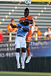 02 June 2012: Carolina's Gale Agbossoumonde (17) heads the ball over Puerto Rico's Yaw Danso (GHA) (28). The Carolina RailHawks defeated the Puerto Rico Islanders 2-1 at WakeMed Soccer Stadium in Cary, NC in a 2012 North American Soccer League (NASL) regular season game.