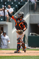 Norfolk Tides catcher Audry Perez (24) makes a throw to third base against the Charlotte Knights at BB&T BallPark on June 7, 2015 in Charlotte, North Carolina.  The Tides defeated the Knights 4-1.  (Brian Westerholt/Four Seam Images)