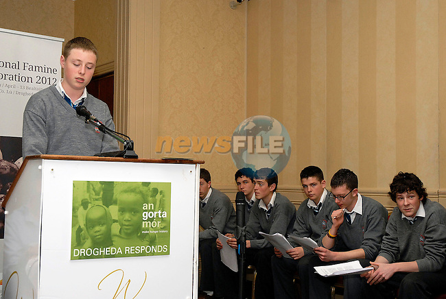 Jack Reilly, a transition year student from St. Josephs CBS Drogheda, speaking at the Gorta Making Hunger History: Local Heroes in faraway places seminar as t his colleagues in the India Immersion project wait their turn to speak.