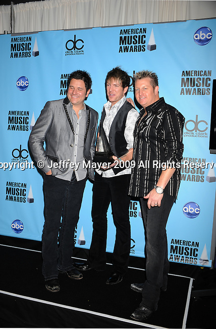 LOS ANGELES, CA. - November 22: Jay DeMarcus, Joe Don Rooney, and Gary LeVox of Rascal Flatts pose in the press room at the 2009 American Music Awards at Nokia Theatre L.A. Live on November 22, 2009 in Los Angeles, California.