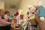 "WATERBURY, CT-31January 2005-013105TK03(left to right:) At St. Mary's Hospital in Waterbury, Bonnie Forcucci, Director of Patient Access and Jan Weber of Nursing Administration put the finishing touches on 25 baskets that will be auctioned off at St. Mary's annual Gala. The Saint Mary's Hospital Foundation, Inc. will present the fourteenth Annual Gala with a theme called ""Young At Heart."" Over 800 are expected to the attend the fund raising gala Saturday night that will benefit the Cardiac Care Service of  St. Mary's Hospital. Tom Kabelka  photo (St. Mary's Hospital, Bonnie Forcucci, Jan Weber)CQ"