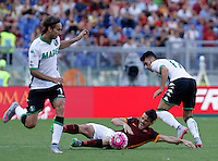 Calcio, Serie A: Roma vs Sassuolo. Roma, stadio Olimpico, 20 settembre 2015.<br /> Roma&rsquo;s Alessandro Florenzi, center, is fouled by Sassuolo&rsquo;s Nicola Sansone, right, during the Italian Serie A football match between Roma and Sassuolo at Rome's Olympic stadium, 20 September 2015. At left, Simone Missiroli.<br /> UPDATE IMAGES PRESS/Isabella Bonotto