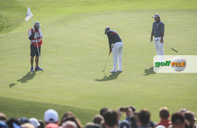 Tiger Woods (Team USA) and Patrick Reed (Team USA) practice putt on the 9th during Friday's Fourballs, at the Ryder Cup, Le Golf National, Îls-de-France, France. 28/09/2018.<br /> Picture David Lloyd / Golffile.ie<br /> <br /> All photo usage must carry mandatory copyright credit (© Golffile | David Lloyd)