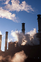 AVAILABLE FROM GETTY IMAGES FOR COMMERCIAL AND EDITORIAL LICENSING. <br /> <br /> Please go to www.gettyimages.com and search for image # 200356029-001...Power Plant and Smoke Stacks Backlit in Early Morning Light, New York City, New York State, USA