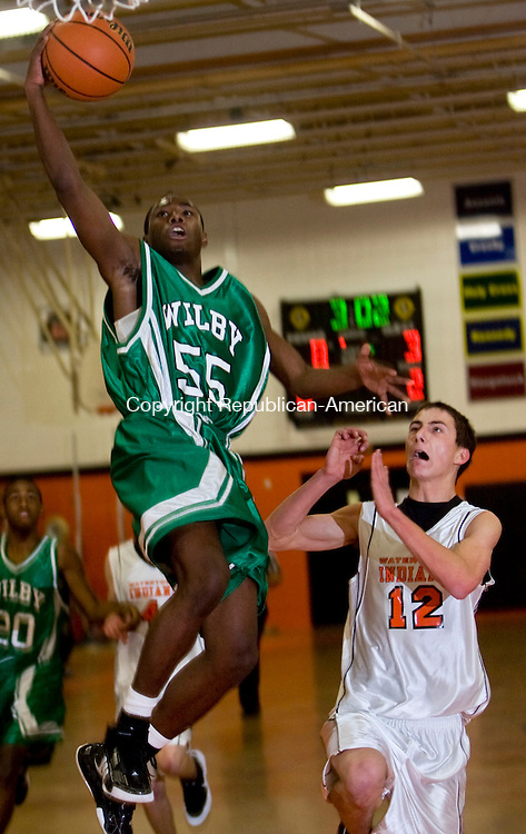 WATERTOWN, CT - 08 JANUARY 2009 -010809JT07-<br /> Wilby's Delvon Allen outruns Watertown's Matthew Quatrano to the basket during Thursday's game at Watertown. Watertown won 55-54 in overtime.<br /> Josalee Thrift / Republican-American