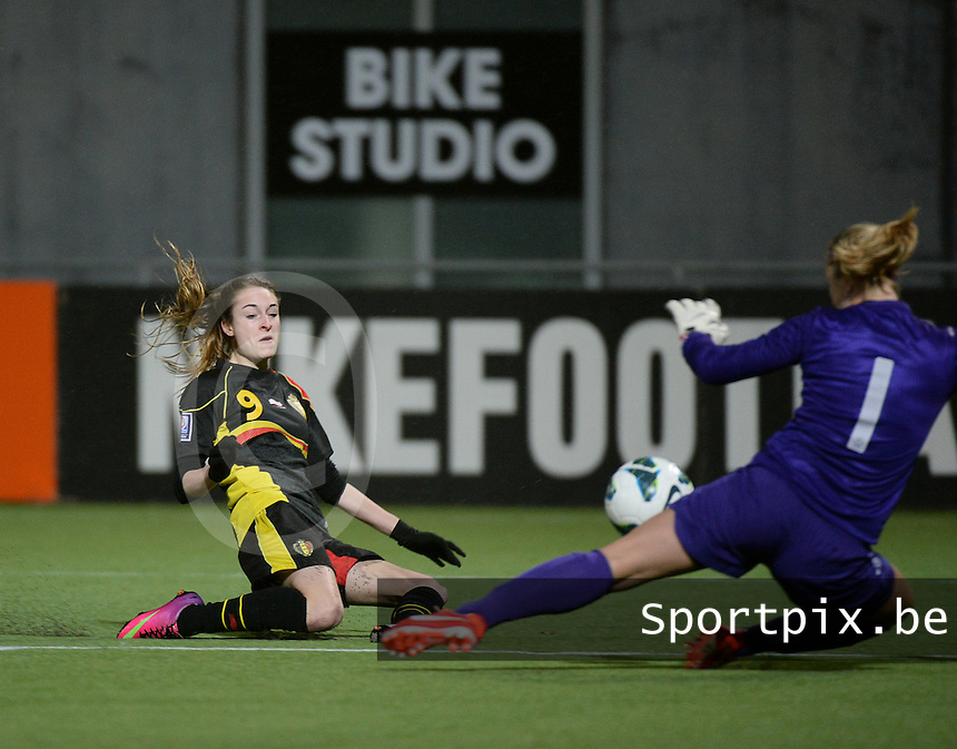 20140212 - ZWOLLE , THE NETHERLANDS : Belgian Tessa Wullaert (l) pictured in front of Dutch Goalkeeper Loes Geurts (r) during the female soccer match between The Netherlands and Belgium , on the fifth matchday in group 5 of the UEFA qualifying round to the FIFA Women World Cup in Canada 2015 at Het Ijseldelta Stadion , Zwolle . Wednesday 12th February 2014 . PHOTO DAVID CATRY