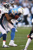 11/27/11 San Diego, CA: San Diego Chargers tight end Antonio Gates #85 and Denver Broncos defensive end Jason Hunter #52 during an NFL game played between the Denver Broncos and the San Diego Chargers at Qualcomm Stadium. The Broncos defeated the Chargers 16-13 in OT