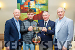 At the Tralee golf club dinner last Saturday night in the Ballyroe heights hotel, Tralee, young Mark Leahy from Tralee receives the Golfer of the Year cup from the captain of the club, John O'Brien, also pictured are Marks dad, Tim, Lt, and Vice Captain, Richared Barrett.