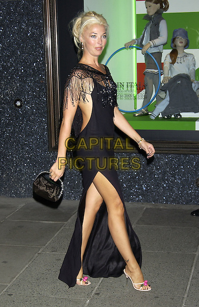 TAMARA BECKWITH.Made in Italy Party at Harrods, Knightsbridge, London, September 9th 2004..full length black dress side split leg tasseled fringed cape wrap shawl pink cherry open toe shoes.Ref: PL.www.capitalpictures.com.sales@capitalpictures.com.©Capital Pictures.
