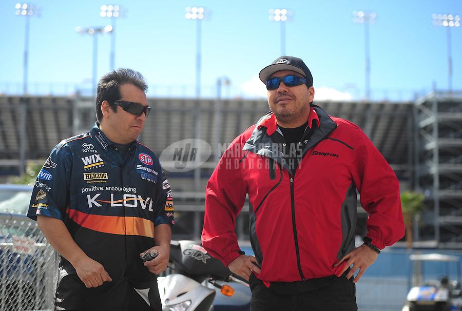 Apr. 1, 2012; Las Vegas, NV, USA: NHRA funny car driver Cruz Pedregon (right) talks with his brother Tony Pedregon during the Summitracing.com Nationals at The Strip in Las Vegas. Mandatory Credit: Mark J. Rebilas-