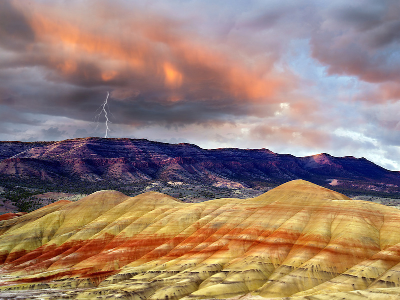 Storm clouds lightening strike and sunset. Painted Hills, John Day Fossil Beds National Monument, Oregon.