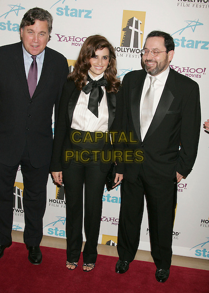 PENELOPE CRUZ & GUESTS.Hollywood Film Festival 10th Annual Hollywood Awards Gala Ceremony  held at the Beverly Hilton Hotel. Photo Credit: Russ Elliot/AdMedia.October 23rd, 2006.Ref: ADM/RE.full length black bow scarf neck tie collar white shirt jacket high waisted trousers suit.www.capitalpictures.com.sales@capitalpictures.com.©Russ Elliot/AdMedia/Capital Pictures.