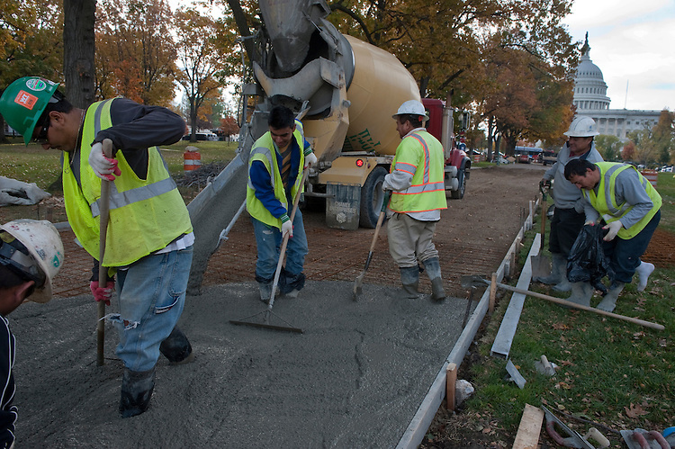 UNITED STATES - November 12: Workers set concrete on a new walkway going in at the Upper Senate Park with the U.S. Capitol in the background on November 12, 2012. (Photo By File Photo/CQ Roll Call)