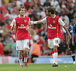 Arsenal's Alexander Hleb celebrates his goal with Matthew Flamini. .Pic SPORTIMAGE/David Klein