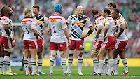 George Robson of Harlequins (centre) talks to Chris Robshaw of Harlequins and team mates during the Premiership Rugby Round 1 match between London Irish and Harlequins at Twickenham Stadium on Saturday 6th September 2014 (Photo by Rob Munro)