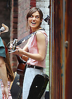 "Keira Knightley plays guitar on the set with Mark Ruffalo of "" Can a song save your life?"