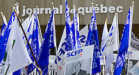 Flags are raised in front of the Quebecor owned Journal de Quebec newspaper office during  protest for the one-year mark of the lockout in Quebec city April 20, 2007.
