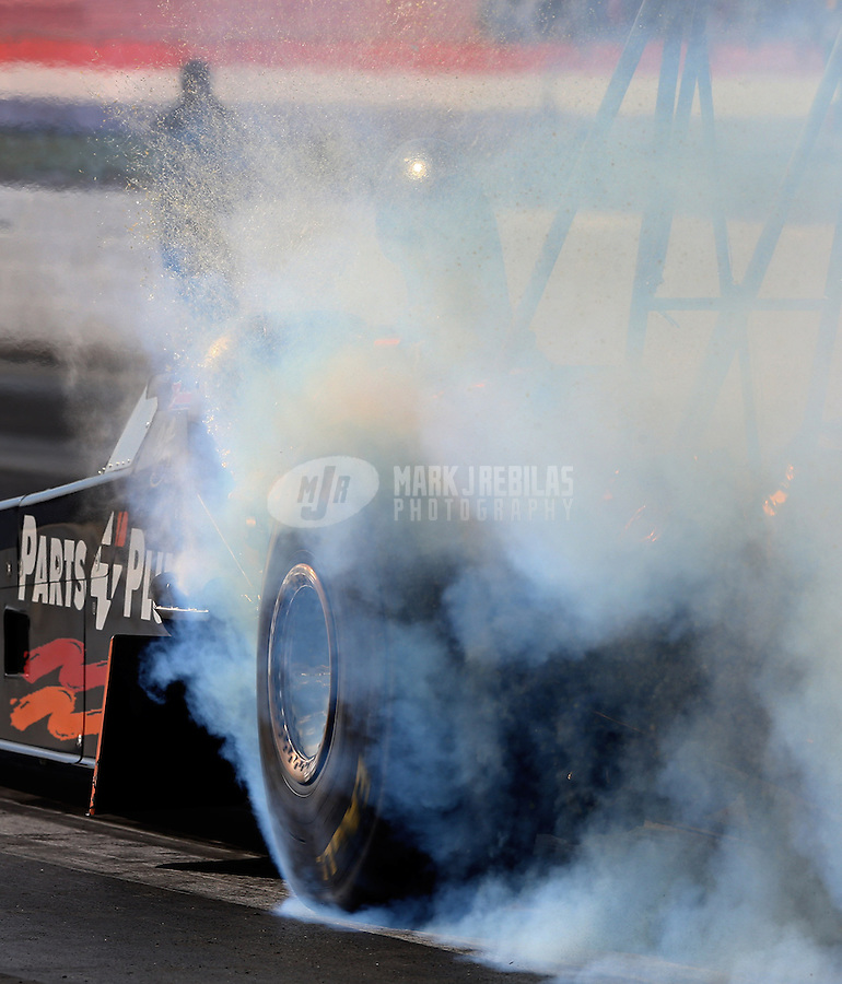 May 16, 2014; Commerce, GA, USA; NHRA top fuel dragster driver Clay Millican during qualifying for the Southern Nationals at Atlanta Dragway. Mandatory Credit: Mark J. Rebilas-USA TODAY Sports
