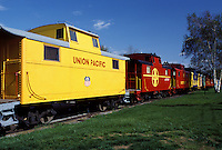 motel, caboose, hotel, Strasburg, Lancaster County, Pennsylvania Dutch Country, Amish Country, Pennsylvania, Colorful red and yellow (Union Pacific and Santa Fe) cabooses at The Red Caboose Motel in Strasburg.