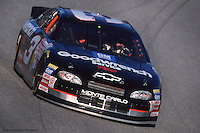 ROCKINGHAM, NC - FEBRUARY 21: Dale Earnhardt drives during practice for the Dura Lube/Big K 400 on February 21, 1999, at the North Carolina Motor Speedway near Rockingham, North Carolina.