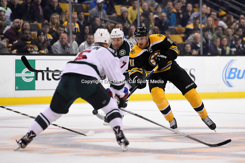 Thursday, November 19, 2015: Boston Bruins right wing Jimmy Hayes (11) tries passing the puck trough the neutral zone during the National Hockey League game between the Minnesota Wild and the Boston Bruins held at TD Garden, in Boston, Massachusetts. The Bruins defeat the Wild 4-2. Eric Canha/CSM