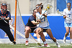 01 May 2016: North Carolina's Aly Messinger (27) is defended by Syracuse's Kaeli O'Connor (behind). The University of North Carolina Tar Heels played the Syracuse University Orange at Lane Stadium in Blacksburg, Virginia in the 2016 Atlantic Coast Conference Women's Lacrosse Tournament championship match. North Carolina won 15-14 in overtime.