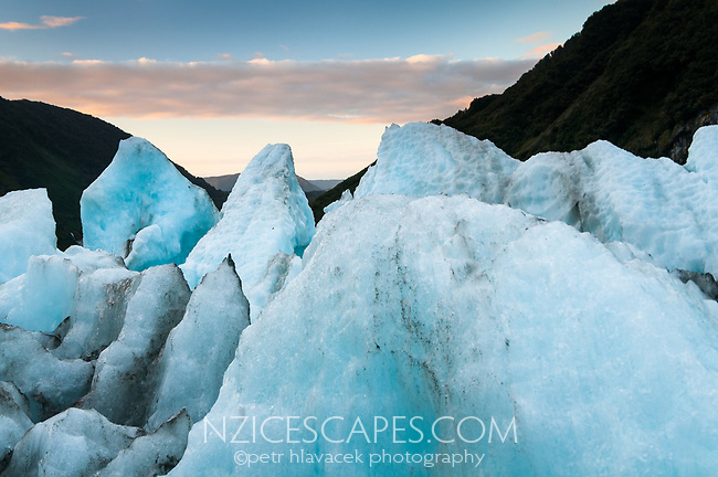 Sunset views from top of terminus of Franz Josef Glacier, Westland Tai Poutini National Park, West Coast, UNESCO World Heritage Area, New Zealand, NZ