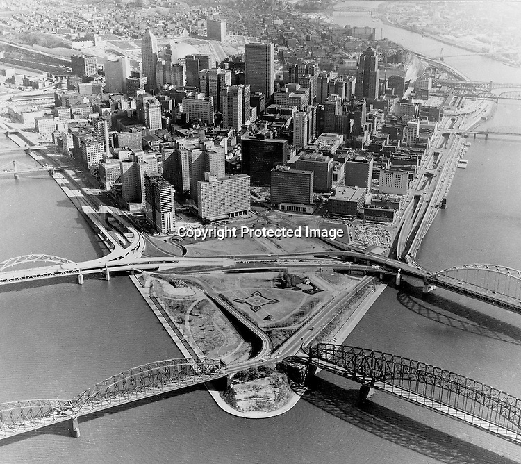 Pittsburgh PA:  Aerial View of Pittsburgh and the Gateway Towers construction - 1964.  Gateway Towers is under construction (next to Hilton) and Point State Park is taking shape.