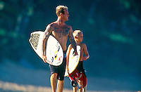 Matt Archibold (USA) and son, Beach Park, Hawaii..photo:  joliphotos.com