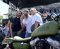 NWA Democrat-Gazette/BEN GOFF @NWABENGOFF<br /> Scotty 'Memphis' Robertson and Matt Gillen of Steele, Mo. pose with their 'Jarhead' U.S. Marine Corps-inspired bike on Saturday Sept. 26, 2015 during the Stokes Air Battle of the Bikes at the annual Bikes, Blues & BBQ motorcycle rally in downtown Fayetteville.