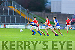 Kerins O'Rahillys David Moran been held by East Kerrys Shane Cronin in the County Football Championship 3rd round on Saturday.