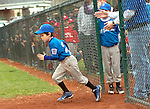 A Little Leaguer runs onto the field during introductions on opening day of Little League.