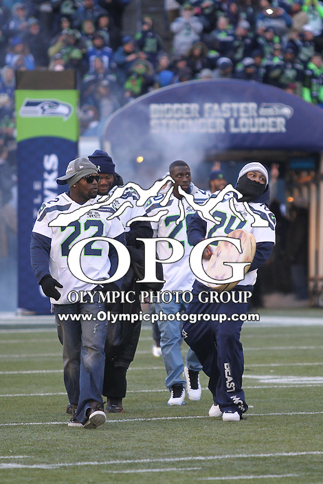2014-02-05:  Seattle Seahawks running back Marshawn Lynch walked out on the field beating a tribal drum. Seattle Seahawks players and 12th man fans celebrated bringing the Lombardi trophy home to Seattle during the Super Bowl Parade at Century Link Field in Seattle, WA.
