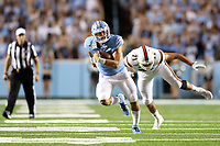 CHAPEL HILL, NC - SEPTEMBER 07: Sam Howell #7 of the University of North Carolina runs past Scott Patchan #71 of the University of Miami during a game between University of Miami and University of North Carolina at Kenan Memorial Stadium on September 07, 2019 in Chapel Hill, North Carolina.