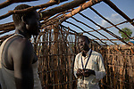 Ganun Butros Wadko talks with a man in the Doro Refugee Camp in Maban County, South Sudan. Doro is one of four camps in Maban which together shelter more than 130,000 refugees from the Blue Nile region of Sudan. Jesuit Refugee Service, with support from Misean Cara, provides educational and psychosocial services to both refugees and the host community. Wadko, a refugee himself, is supervisor of the JRS psychosocial team's home visits in the Doro Camp.
