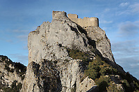 "Chapelle San Jordi (left) and High Castle (right), Peyrepertuse Castle or Chateau Pierre Pertuse, Cathar Castle, Duilhac-sous-Peyrepertuse, Corbieres, Aude, France. This castle consists of a Lower Castle built by the Kings of Aragon in the 11th century and a High Castle built by Louis IX in the 13th century, joined by a huge staircase. Its name means pierced rock in Occitan and it has been associated with the Counts of Narbonne and Barcelona. It is one of the ""Five Sons of Carcassonne"" or ""cinq fils de Carcassonne"" and is a listed monument historique. Picture by Manuel Cohen"