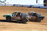 Apr 16, 2011; Surprise, AZ USA; LOORRS driver Chad George (42) races alongside Austin Kimbrell (88) during round 3 at Speedworld Off Road Park. Mandatory Credit: Mark J. Rebilas-.