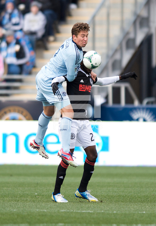 Matt Besler (5) of Sporting Kansas City goes up for a header over Keon Daniels (26) of  the Philadelphia Union during the game at PPL Park in Chester, PA.  Kansas City defeated Philadelphia, 3-1.