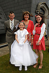 Eibhlyn Mullen who made her First Holy Communion in Julianstown on Saturday pictured with her parents Andrea and Eileen and big sister Patricia.