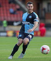 Matt Bloomfield of Wycombe Wanderers plays a pass during the Sky Bet League 2 match between Leyton Orient and Wycombe Wanderers at the Matchroom Stadium, London, England on 19 September 2015. Photo by Andy Rowland.