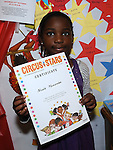 Nicole Masamba pictured with his certificate for the Circus Stars summer reading project at the library. Photo: Colin Bell/pressphotos.ie