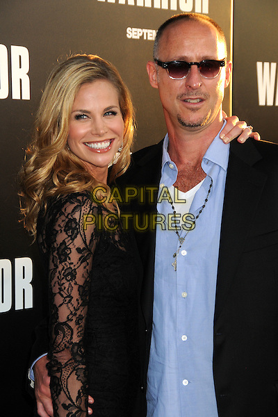 "Brooke Burns & Gavin O' Connor.""Warrior"" World Premiere held at Arclight Cinemas, Hollywood, California, USA..September 6th, 2011.half length dress suit jacket blue shirt sunglasses shades couple side black lace smiling  .CAP/ADM/BP.©Byron Purvis/AdMedia/Capital Pictures."